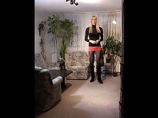 Crossdresser Sandy wearing short Skirt, Pantyhose and Boots