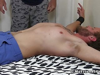 Perverted gay freaks tickle a bound stud into submission