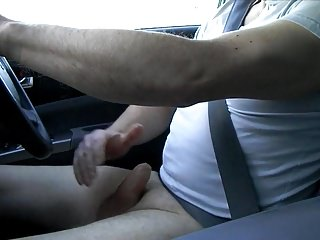 Driving wank, wearing only a t-shirt