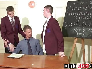 Young teacher anally fucked by his two big cocked students